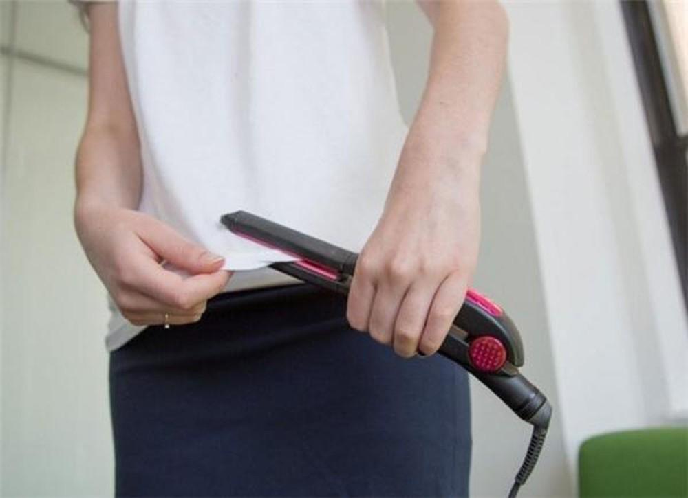 прасування щипцями для волосся